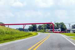 Red pipeline above the street Royalty Free Stock Photo