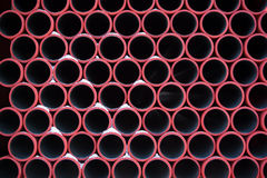 Red pipes pattern stock photos