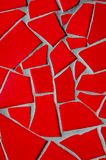 Red Pique Assiette. A red broken tile mosaic background pattern Stock Photography