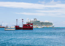 Red Pirate and Cruise Ships Stock Photo