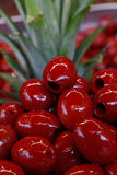 Red pitted Cerignola olives in oil close up Royalty Free Stock Photography