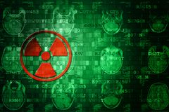 Red pixelated radiation icon on green digital background with copy space. Science concept Stock Photography