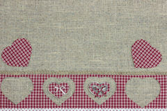 Red plaid country border with hearts on shabby burlap background Stock Images