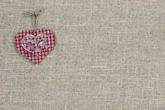 Red plaid country heart hanging on burlap sign Royalty Free Stock Photos