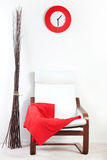 Red plaid draped over a chair Stock Photo
