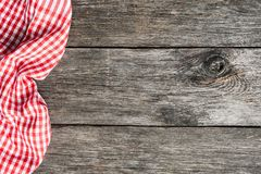 Red plaid kitchen textile on old wooden background. Cooking food Pizza Picnic background with copy space for text Stock Photos