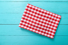 Red plaid tablecloth on blue wooden table. Top view and copy space. Mock up Stock Photography