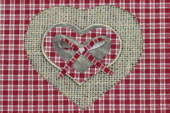 Red plaid and wood country hearts with shabby burlap background Stock Photography