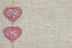 Red plaid and wood hearts border shabby burlap background Royalty Free Stock Images