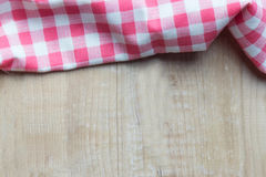 Red plaid on wooden table. High angle view Royalty Free Stock Photography