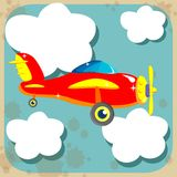Red plane among the clouds Stock Photos
