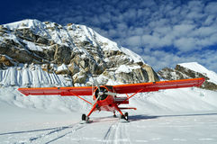 Red plane on a glacier royalty free stock image