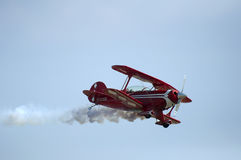 Red plane looping Stock Photo