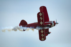 Red plane looping Stock Photography