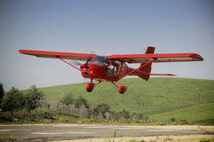 Red plane manned by student and teacher of a class flight practice, Jaen, Andalusia, Spain stock image