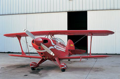 Red plane and open hangar door Royalty Free Stock Photography
