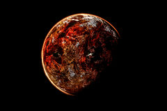Red planet. In a black background royalty free stock images