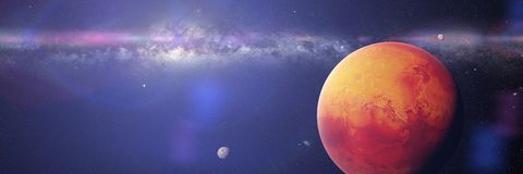 The red planet Mars with it moons Phobos and Deimos, part of the Milky Way galaxy. Artist`s interpretation of the red, outer space planet panorama banner royalty free stock photography