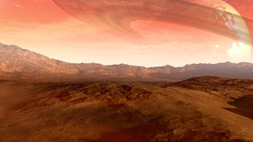 Red planet with Saturn-like moon Royalty Free Stock Image
