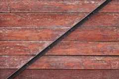 Red planks background with black metal bar Royalty Free Stock Photography
