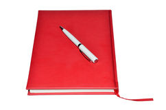 Red planner and white pen Royalty Free Stock Photo