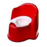 Red plastic baby potty. Stock Photos