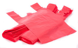 Red plastic bags. Plastic bags on white background Stock Photo