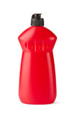 Red plastic bottle with cleaning liquid. Standing on a white Stock Photos