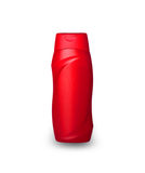 Red plastic bottle with male shampoo Stock Photography
