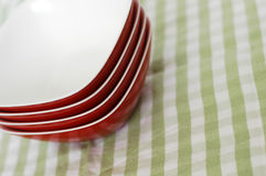 Red plastic bowls green cloth Stock Photography