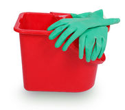 Red plastic bucket and green rubber glove Stock Photo