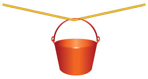 Red plastic bucket on a rope Stock Photos