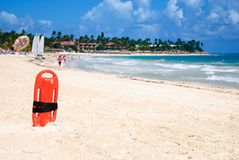 Red plastic buoy for a lifeguard ready to save people on beach Stock Image