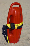 Red plastic buoyancy aid. In the sand, cala bona beach, mallorca, majorca, spain stock photo