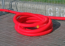 Red plastic cable bulk on the street, Stock Photo