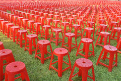 Red plastic chair Stock Images