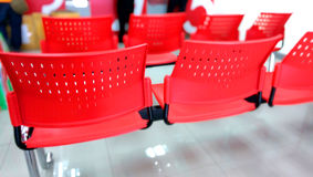 Red plastic chair. In the post office Royalty Free Stock Photography