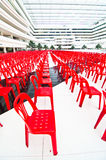 Red plastic chairs Stock Photos