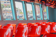 Red plastic chairs Stock Photography