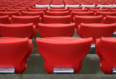 Red plastic chairs at the stadium Royalty Free Stock Photography