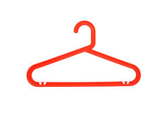 Red plastic clothes hanger. Isolated Stock Photos