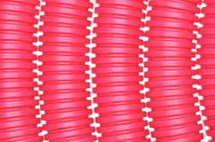Red plastic corrugated pipe Royalty Free Stock Photography