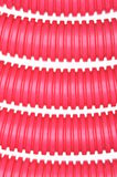 Red plastic corrugated pipe Stock Photos