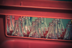 Red Plastic Crate with Empty Glass Bottles Royalty Free Stock Photography