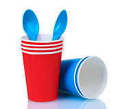 Red plastic cups and blue spoons Stock Photo