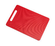 Red plastic cutting board Stock Image