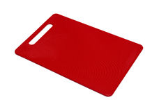 Red plastic cutting board Royalty Free Stock Image