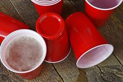 Red Plastic Drinking Cups and Spilled Beer Stock Images