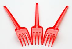 Red plastic forks Stock Photo