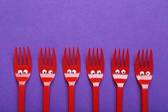 Red plastic forks Royalty Free Stock Images